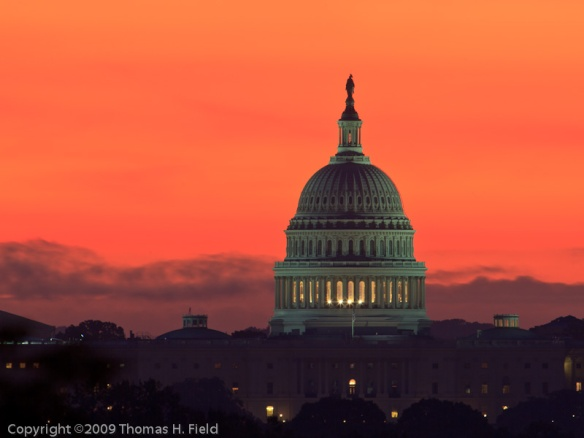 Sunrise behind the dome of the US Capitol.